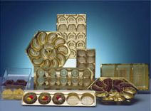 Decorative thermoformed inserts for the sweets industry